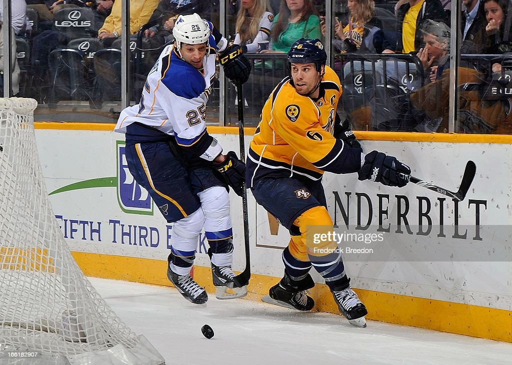 Chris Stewart #25 of the St Louis Blues and <a gi-track='captionPersonalityLinkClicked' href=/galleries/search?phrase=Shea+Weber&family=editorial&specificpeople=554412 ng-click='$event.stopPropagation()'>Shea Weber</a> #6 of the Nashville Predators skate for the puck at the Bridgestone Arena on April 9, 2013 in Nashville, Tennessee.