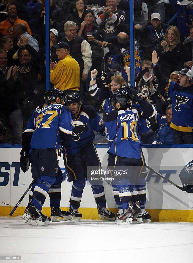Chris Stewart #25 of the St. Louis Blues celebrates with teammates after scoring a goal in an NHL game against the Detroit Red Wings on January 19, 2013 at Scottrade Center in St. Louis, Missouri.