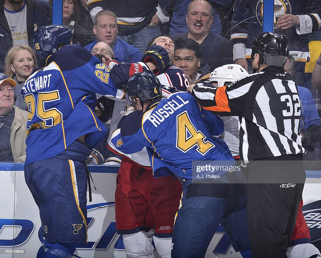 Chris Stewart #25 of the St. Louis Blues gets physical with <a gi-track='captionPersonalityLinkClicked' href=/galleries/search?phrase=R.J.+Umberger&family=editorial&specificpeople=636608 ng-click='$event.stopPropagation()'>R.J. Umberger</a> #18 of the Columbus Blue Jackets in an NHL game on February 23, 2013 at Scottrade Center in St. Louis, Missouri.