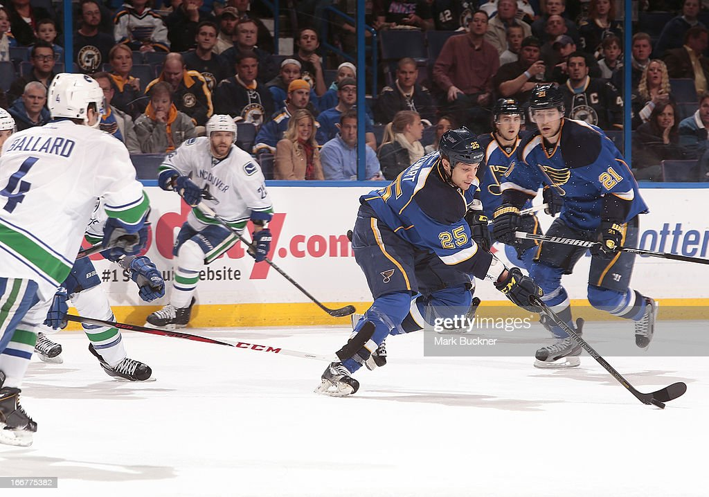 Chris Stewart #25 of the St. Louis Blues handles the puck against Vancouver Canucks in an NHL game on April 16, 2013 at Scottrade Center in St. Louis, Missouri.
