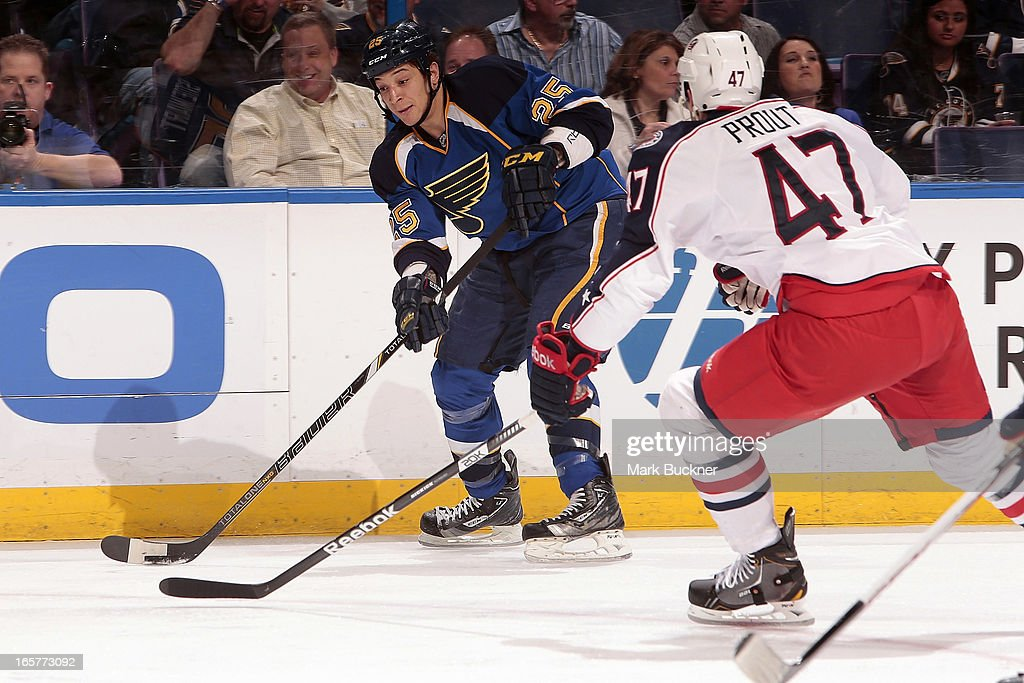 Chris Stewart #25 of the St. Louis Blues handles the puck as <a gi-track='captionPersonalityLinkClicked' href=/galleries/search?phrase=Dalton+Prout&family=editorial&specificpeople=6263673 ng-click='$event.stopPropagation()'>Dalton Prout</a> #47 of the Columbus Blue Jackets defends in an NHL game on April 5, 2013 at Scottrade Center in St. Louis, Missouri.