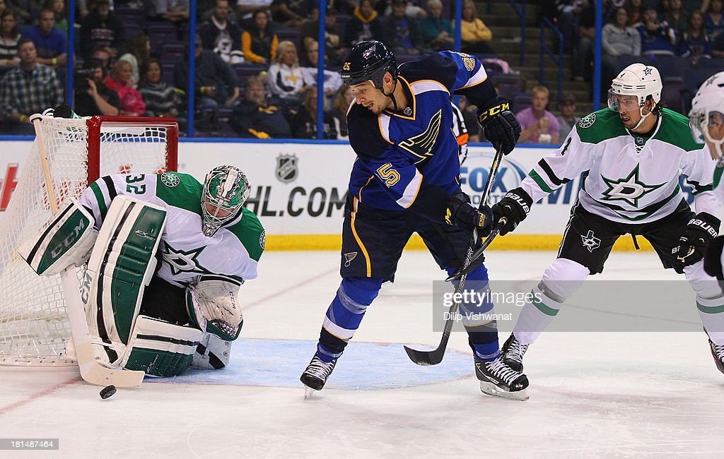 Chris Stewart #25 of the St. Louis Blues looks to tip the puck into the net against Kari Lehtonen #32 and Brenden Dillon #4 of the Dallas Stars during a preseason at the Scottrade Center on September 21, 2013 in St. Louis, Missouri.
