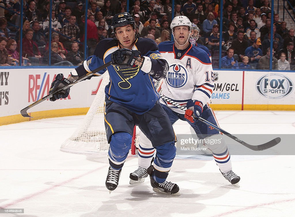 Chris Stewart #25 of the St. Louis Blues skates against <a gi-track='captionPersonalityLinkClicked' href=/galleries/search?phrase=Nick+Schultz&family=editorial&specificpeople=203252 ng-click='$event.stopPropagation()'>Nick Schultz</a> #15 of the Edmonton Oilers in an NHL game on March 26, 2013 at Scottrade Center in St. Louis, Missouri.