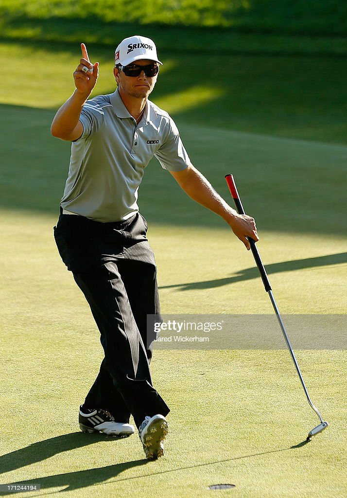<a gi-track='captionPersonalityLinkClicked' href=/galleries/search?phrase=Chris+Stroud&family=editorial&specificpeople=4252206 ng-click='$event.stopPropagation()'>Chris Stroud</a> acknowledges the crowd after finishing the second playoff during the final round of the 2013 Travelers Championship at TPC River Highlands on June 23, 2012 in Cromwell, Connecticut.