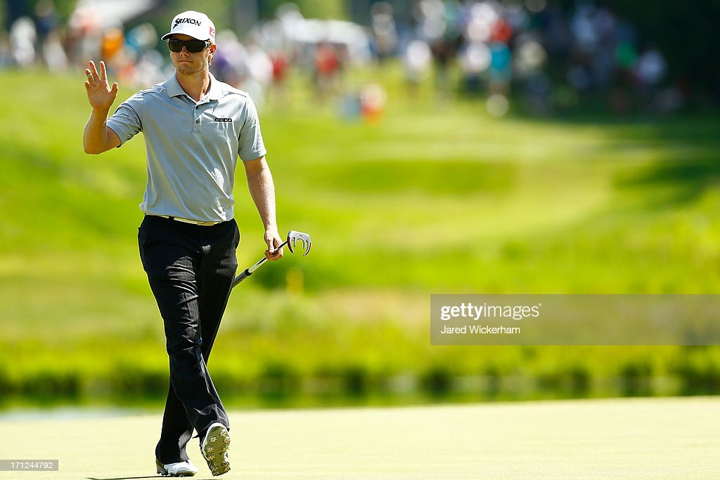 <a gi-track='captionPersonalityLinkClicked' href=/galleries/search?phrase=Chris+Stroud&family=editorial&specificpeople=4252206 ng-click='$event.stopPropagation()'>Chris Stroud</a> acknowledges the crowd on the 8th green during the final round of the 2013 Travelers Championship at TPC River Highlands on June 23, 2012 in Cromwell, Connecticut.