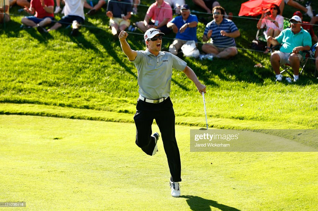 Chris Stroud celebrates after chipping in a birdie on the 18th hole to force a playoff against Ken Duke during the final round of the 2013 Travelers Championship at TPC River Highlands on June 23, 2012 in Cromwell, Connecticut.