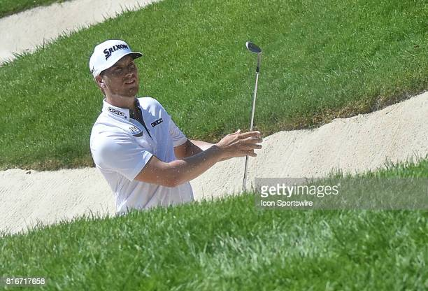 Chris Stroud checks to see where his ball ended up after hitting out of a sand trap on the No 6 hole during the final round of the John Deere Classic...