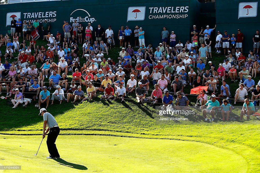 <a gi-track='captionPersonalityLinkClicked' href=/galleries/search?phrase=Chris+Stroud&family=editorial&specificpeople=4252206 ng-click='$event.stopPropagation()'>Chris Stroud</a> chips in a birdie on the 18th hole to force a playoff against Ken Duke during the final round of the 2013 Travelers Championship at TPC River Highlands on June 23, 2012 in Cromwell, Connecticut.