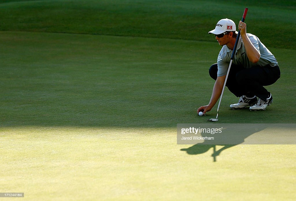 <a gi-track='captionPersonalityLinkClicked' href=/galleries/search?phrase=Chris+Stroud&family=editorial&specificpeople=4252206 ng-click='$event.stopPropagation()'>Chris Stroud</a> lines up his putt on the 18th green during the second playoff of the final round of the 2013 Travelers Championship at TPC River Highlands on June 23, 2012 in Cromwell, Connecticut.