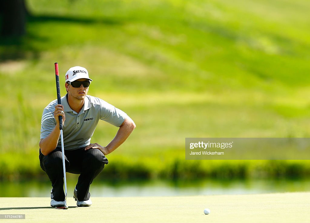 <a gi-track='captionPersonalityLinkClicked' href=/galleries/search?phrase=Chris+Stroud&family=editorial&specificpeople=4252206 ng-click='$event.stopPropagation()'>Chris Stroud</a> lines up his putt on the 8th green during the final round of the 2013 Travelers Championship at TPC River Highlands on June 23, 2012 in Cromwell, Connecticut.