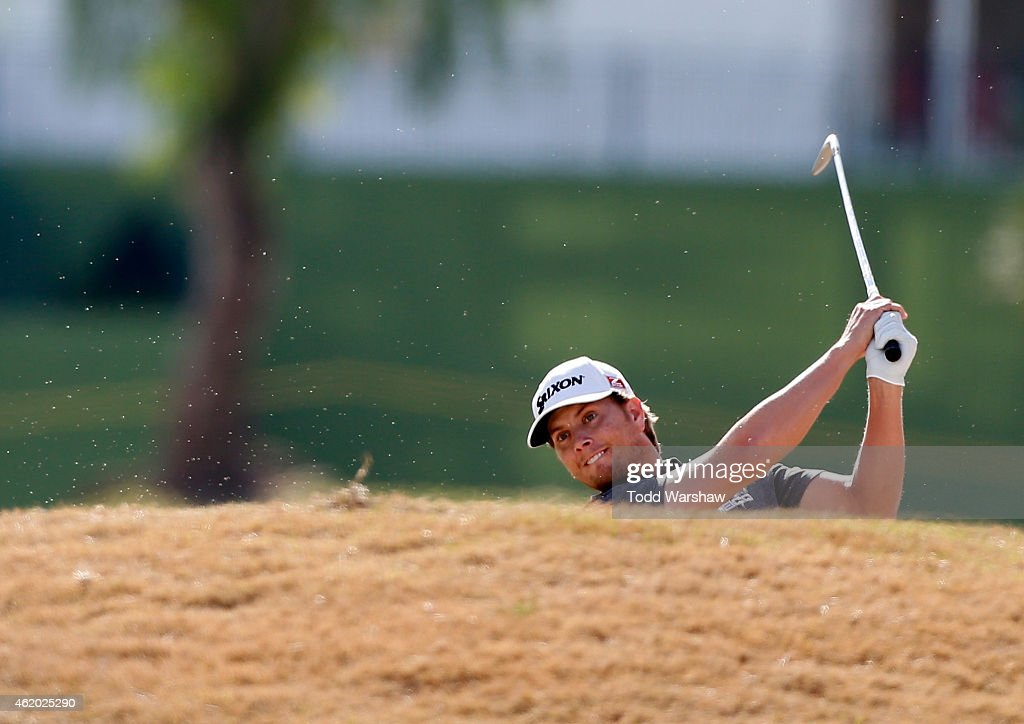 Chris Stroud of the United States takes his shot out of the bunker on the first hole during round two of the Humana Challenge in partnership with The...