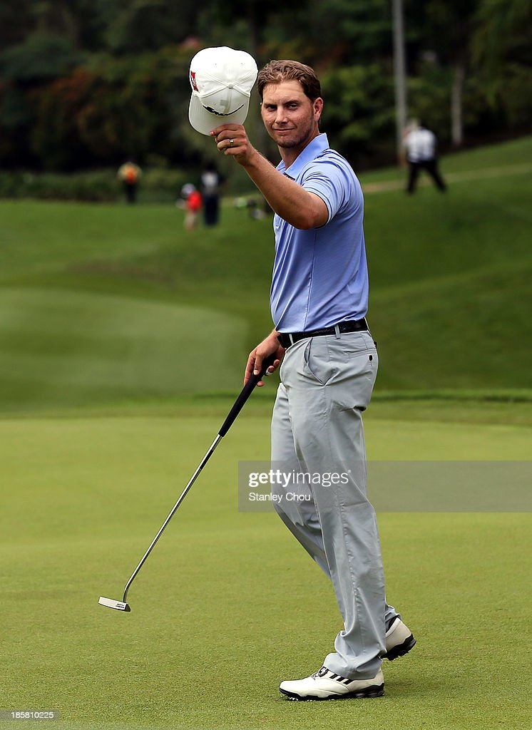 Chris Stroud of USA reacts on the 18th hole during round two of the CIMB Classic at Kuala Lumpur Golf & Country Club on October 25, 2013 in Kuala Lumpur, Malaysia.