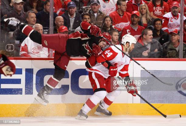 Chris Summers of the Phoenix Coyotes attempts a body check on Todd Bertuzzi of the Detroit Red Wings during the NHL game at Jobingcom Arena on...