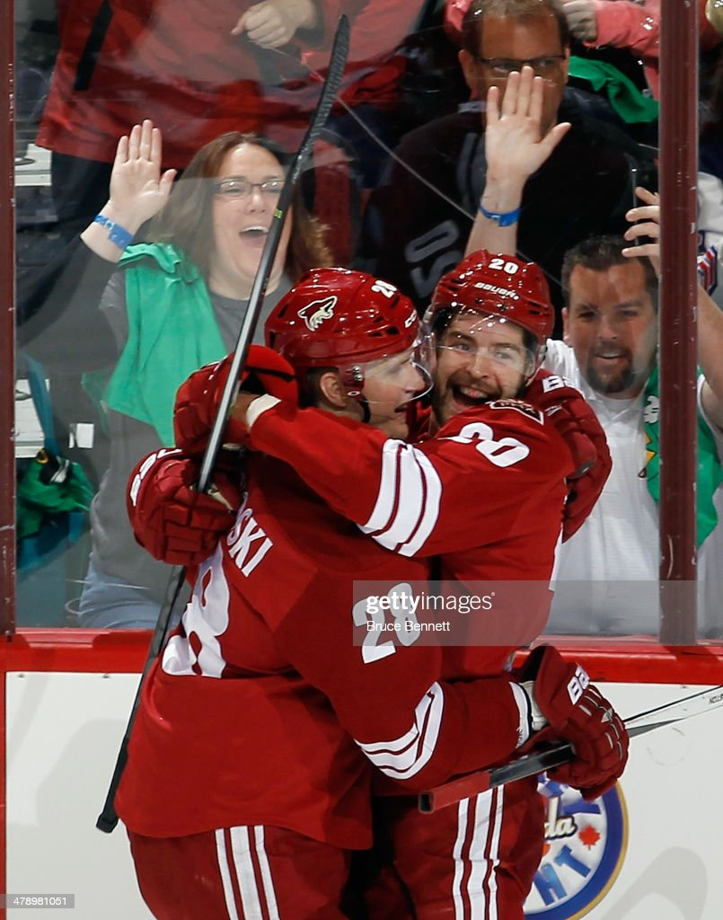 Chris Summers of the Phoenix Coyotes celebrates his first NHL goal at 435 of the first period along with Lauri Korpikoski against the Calgary Flames...