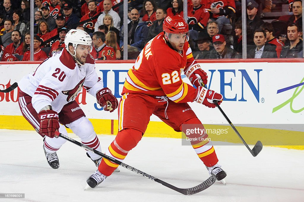 Chris Summers #20 of the Phoenix Coyotes chases <a gi-track='captionPersonalityLinkClicked' href=/galleries/search?phrase=Lee+Stempniak&family=editorial&specificpeople=575240 ng-click='$event.stopPropagation()'>Lee Stempniak</a> of the Calgary Flames into the corner during an NHL game at Scotiabank Saddledome on February 24, 2013 in Calgary, Alberta, Canada.