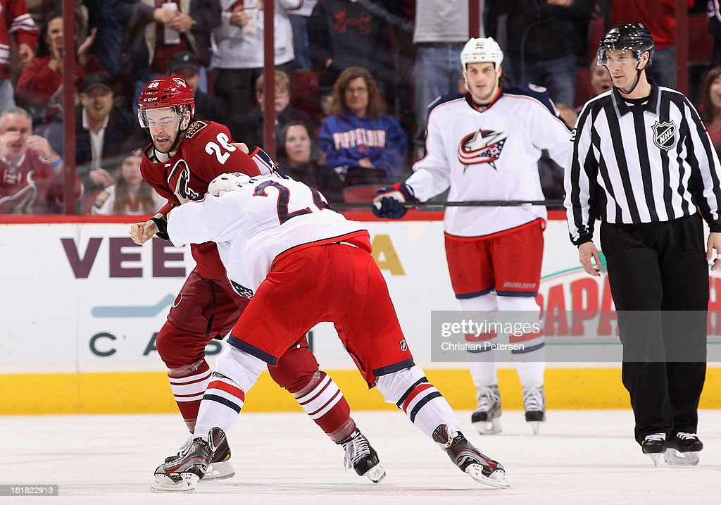 Chris Summers #20 of the Phoenix Coyotes fights with <a gi-track='captionPersonalityLinkClicked' href=/galleries/search?phrase=Derek+MacKenzie&family=editorial&specificpeople=685877 ng-click='$event.stopPropagation()'>Derek MacKenzie</a> #24 of the Columbus Blue Jackets during the third period of the NHL game at Jobing.com Arena on February 16, 2013 in Glendale, Arizona. The Coyotes defeated the Blue Jackets 5-3.
