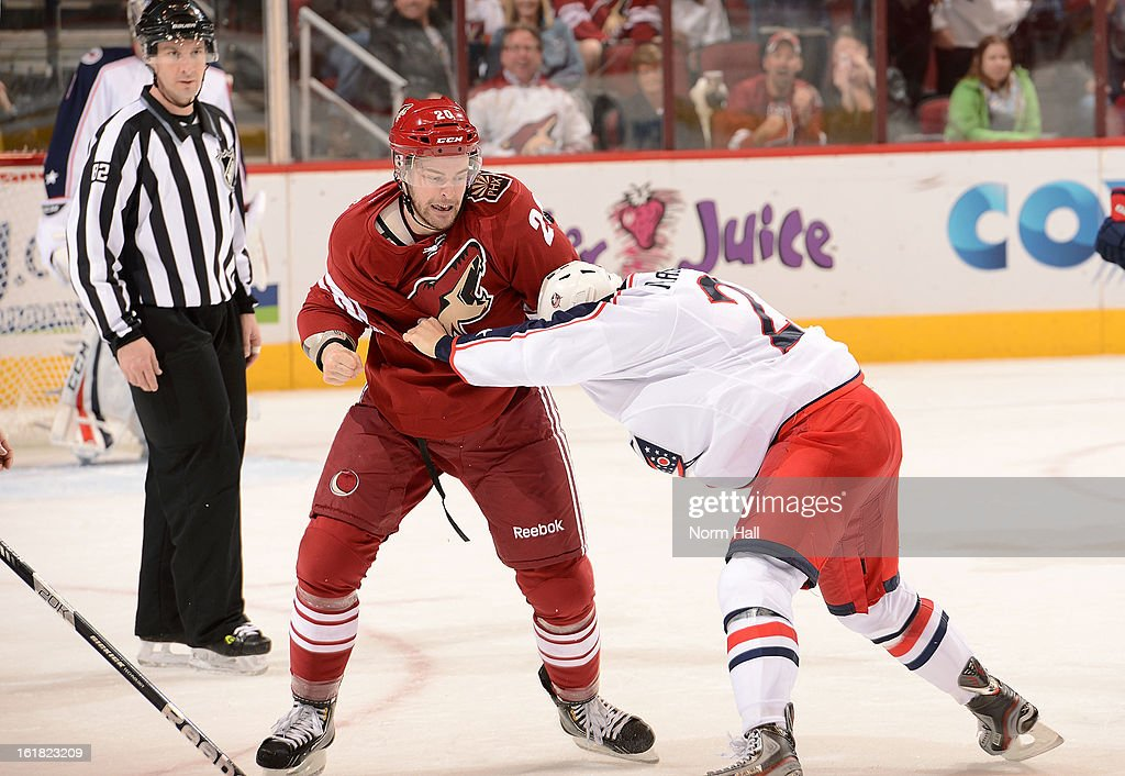 Chris Summers #20 of the Phoenix Coyotes tangles with <a gi-track='captionPersonalityLinkClicked' href=/galleries/search?phrase=Derek+MacKenzie&family=editorial&specificpeople=685877 ng-click='$event.stopPropagation()'>Derek MacKenzie</a> #24 of the Columbus Blue Jackets during the third period at Jobing.com Arena on February 16, 2013 in Glendale, Arizona.