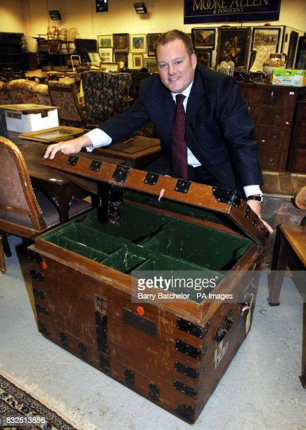 Chris Surfleet Senior Auctioneer and Valuer with Moore Allen Innocent with Lot 1344 a late Victorian iron bound oak silver chest bearing brass plaque...