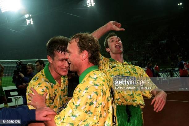 LR Chris Sutton and Jeremy Goss celebrate Norwich City's win over Bayern Munich