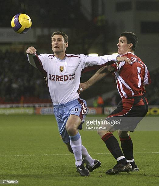 Chris Sutton of Aston Villa holds off Chris Morgan of Sheffield United during the Barclays Premiership match between Sheffield United and Aston Villa...