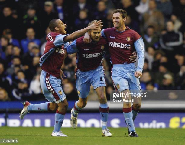 Chris Sutton of Aston Villa is congratulated by teammates Olof Mellberg and Gabriel Agbonlahor after scoring during the Barclays Premiership match...