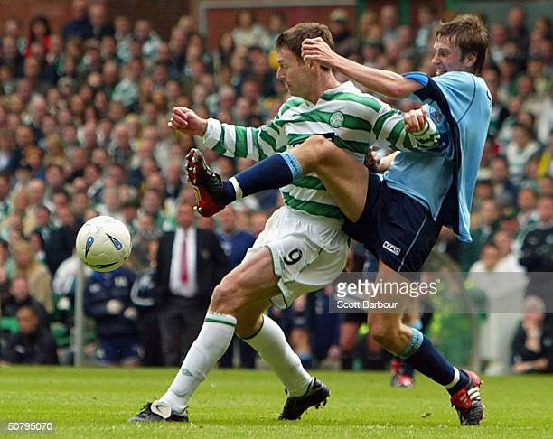 Chris Sutton of Celtic and Andre Skerla of Dunfermline compete for the ball during the Scottish Premier League match between Glasgow Celtic and...