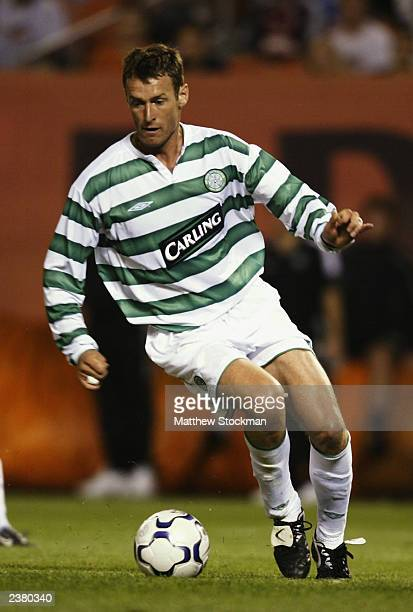 Chris Sutton of Celtic runs with the ball during the PreSeason Friendly match between Glasgow Celtic and Boca Juniors held on July 25 2003 at the...