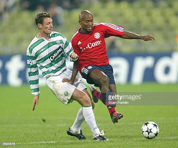 Chris Sutton of Celtic tackles Ze Roberto of Bayern during the UEFA Champions League match between FC Bayern Munich and Glasgow Celtic September 17...