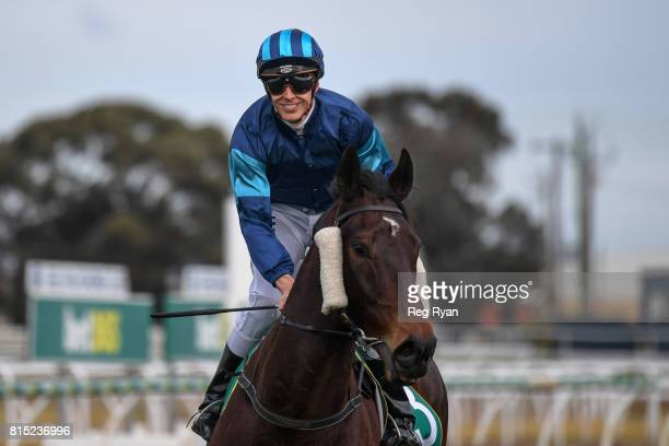 Chris Symons returns to the mounting yard on Rich Luck after winning the Clark Rubber Geelong BM78 Handicap at Geelong Racecourse on July 16 2017 in...