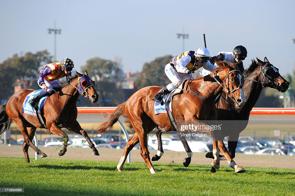 Chris Symons riding Blackie wins from Kayla Nisbet riding Spacecraft in the Alternate Railway Handicap during Melbourne Racing at Moonee Valley Racecourse on June 29, 2013 in Melbourne, Australia.