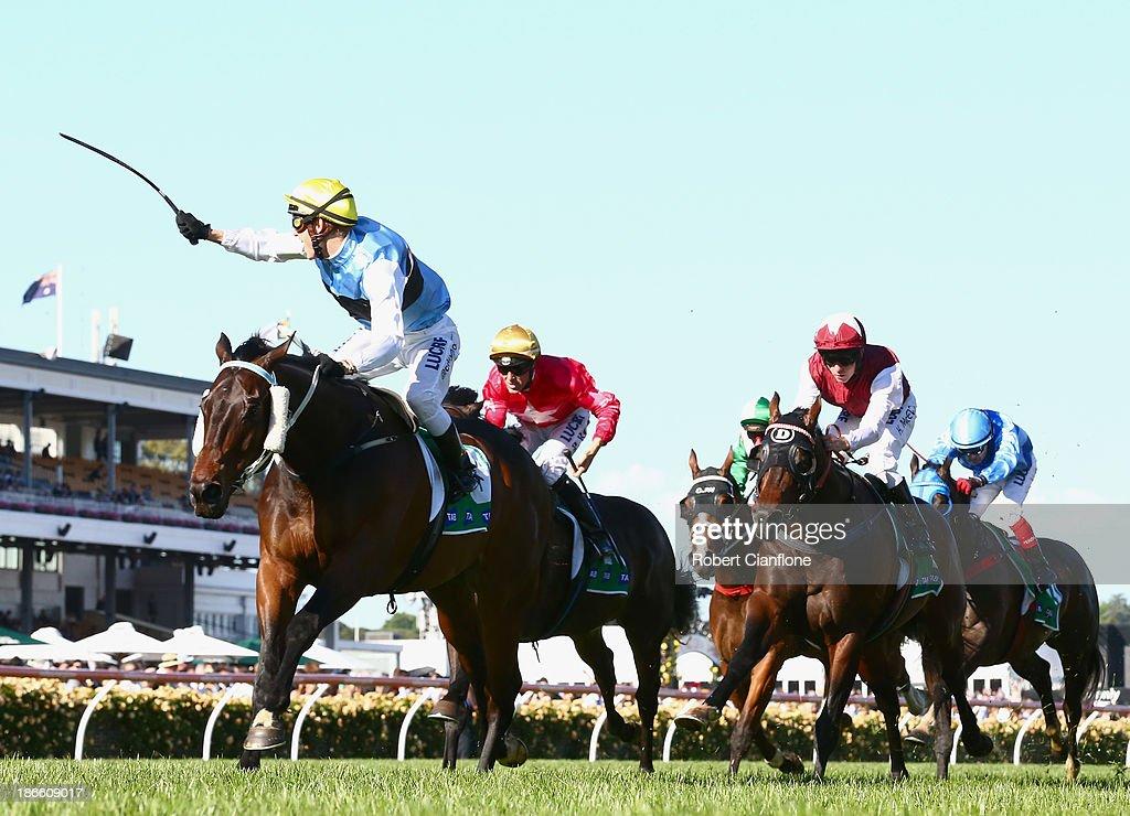 Chris Symons riding #9 Smokin Joe wins race nine the tab.com.au Stakes during Derby Day at Flemington Racecourse on November 2, 2013 in Melbourne, Australia.