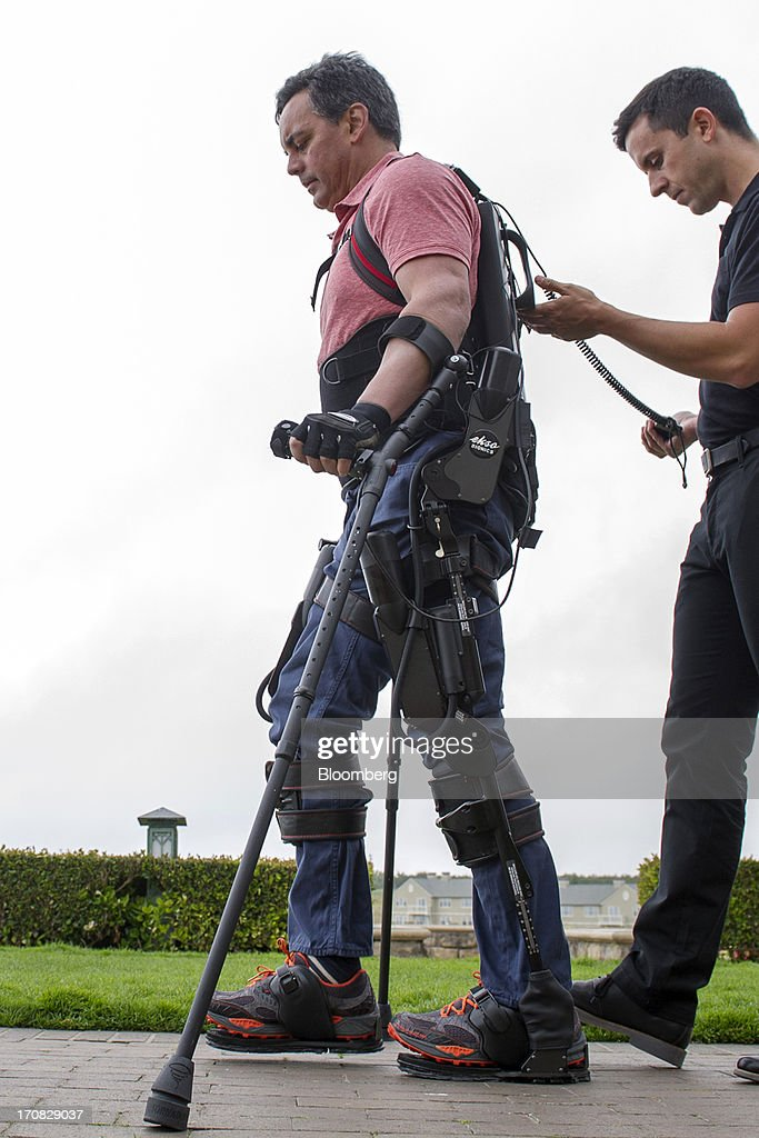 Chris Tagatac uses a bionic suit or exoskeleton made by Esko Bionics during the Bloomberg Next Big Thing summit in Half Moon Bay, California, U.S., on Tuesday, June 18, 2013. The summit convenes investors and entrepreneurs in technology, science and data to examine the future of technology, business and how innovation is changing the human experience. Photographer: David Paul Morris/Bloomberg via Getty Images