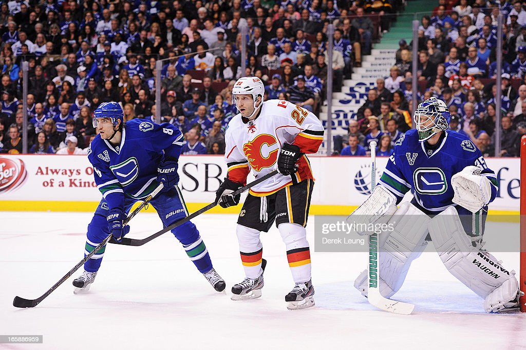 Chris Tanev #8 and <a gi-track='captionPersonalityLinkClicked' href=/galleries/search?phrase=Cory+Schneider&family=editorial&specificpeople=696908 ng-click='$event.stopPropagation()'>Cory Schneider</a> #35 of the Vancouver Canucks defend the net against <a gi-track='captionPersonalityLinkClicked' href=/galleries/search?phrase=Lee+Stempniak&family=editorial&specificpeople=575240 ng-click='$event.stopPropagation()'>Lee Stempniak</a> #22 of the Calgary Flames during an NHL game at Rogers Arena on April 6, 2013 in Vancouver, British Columbia, Canada. The Vancouver Canucks won 5-2.