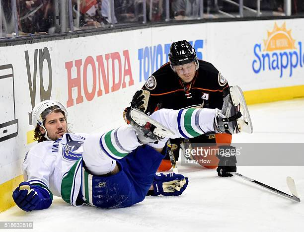Chris Tanev of the Vancouver Canucks reacts as he is tripped for a penalty by Corey Perry of the Anaheim Ducks during the first period at Honda...
