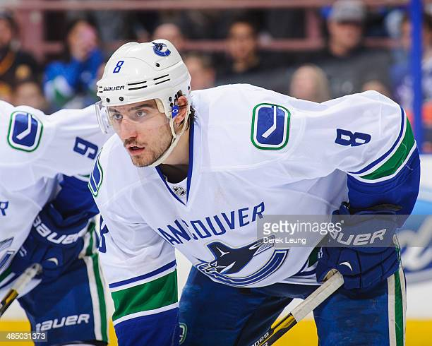 Chris Tanev of the Vancouver Canucks skates against the Edmonton Oilers during an NHL game at Rexall Place on January 21 2014 in Edmonton Alberta...