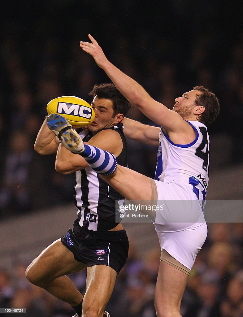 Chris Tarrant of the Magpies attempts to take a mark during the round 21 AFL match between the Collingwood Magpies and the North Melbourne Kangaroos at Etihad Stadium on August 18, 2012 in Melbourne, Australia.
