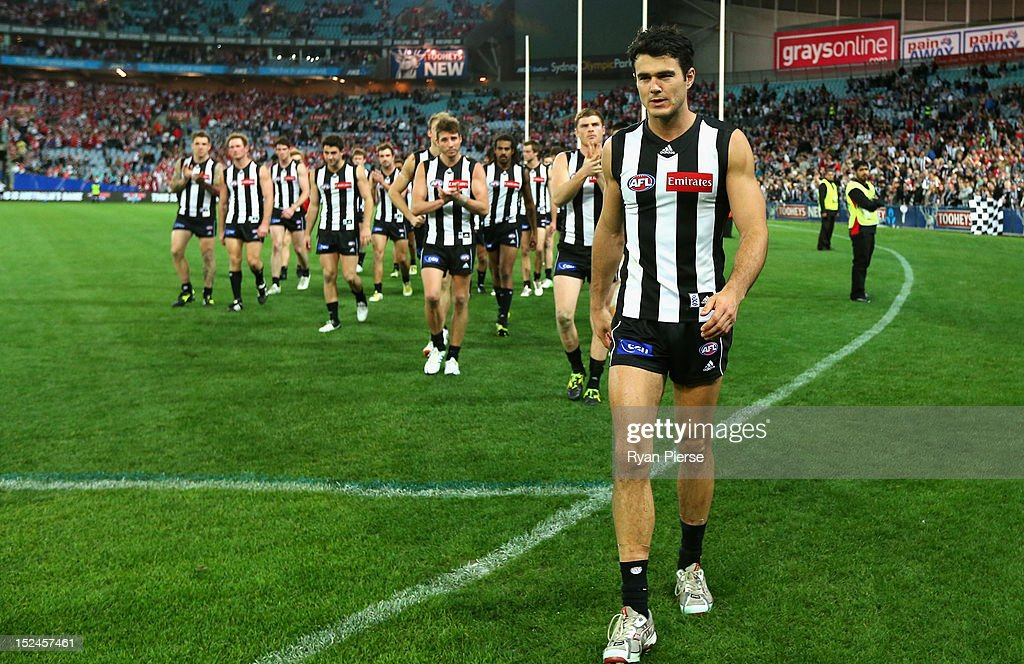 Chris Tarrant of the Magpies leads his team off the ground after the second AFL Preliminary Final match between the Sydney Swans and the Collingwood Magpies at ANZ Stadium on September 21, 2012 in Sydney, Australia.