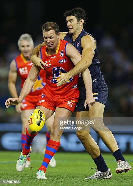 Chris Tarrant of Victoria tackles Wayne Carey of the All Stars during the EJ Whitten Legends match at Etihad Stadium on September 2 2016 in Melbourne...