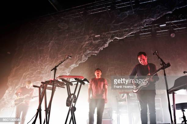 Chris Taylor Ed Droste and Daniel Rossen of the American band Grizzly Bear perform live on stage during a concert at the Huxleys on October 12 2017...