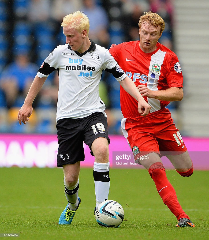 Chris Taylor of Blackburn tackles Will Hughes of Derby during the Sky Bet Championship match between Derby County and Blackburn Rovers at Pride Park Stadium on August 04, 2013 in Derby, England,