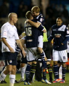 Chris Taylor of Millwall celebrates the win with team mate Mark Beevers at the final whistle during the npower Championship match between Millwall...