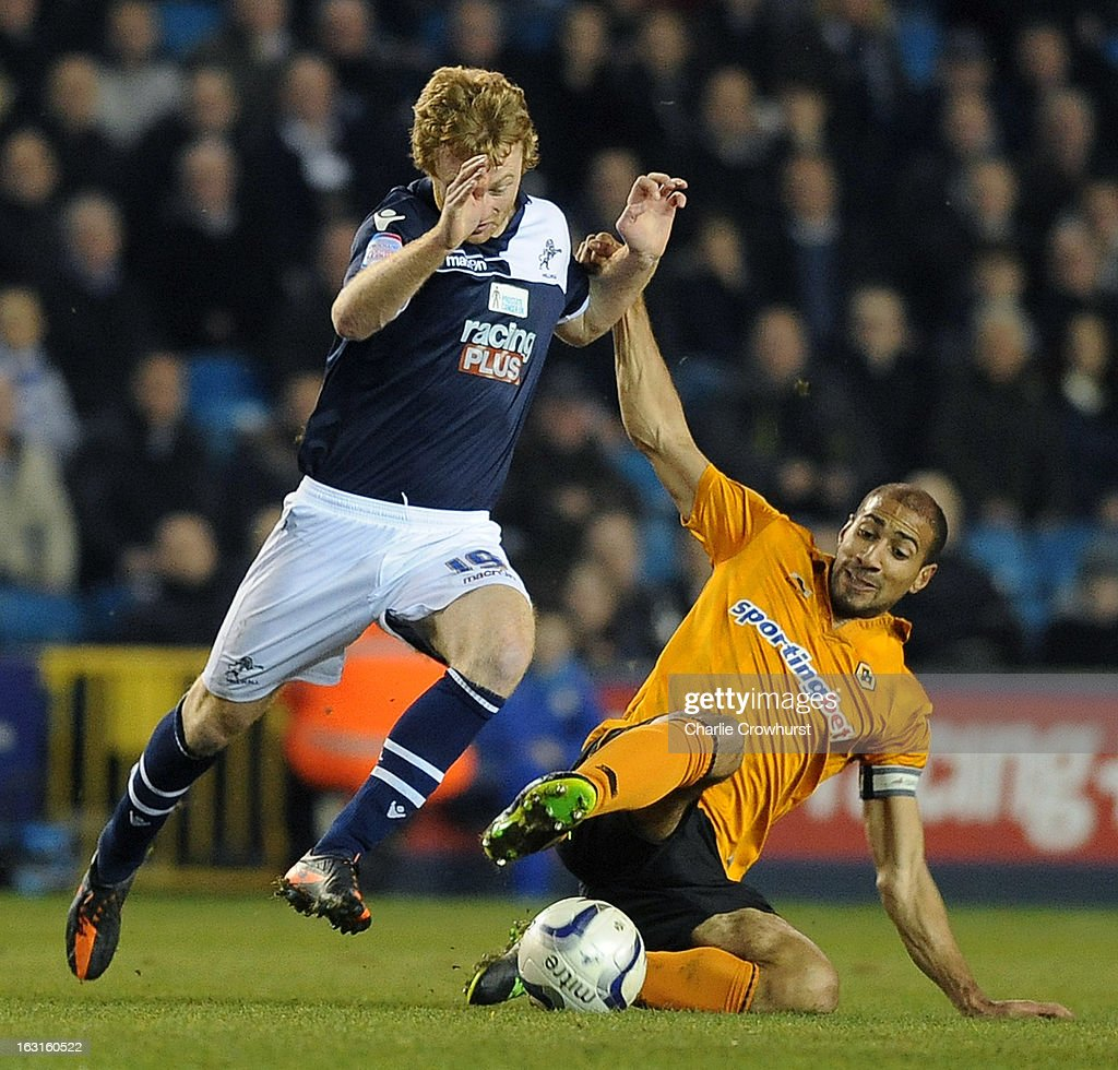 Chris Taylor of Millwall Looks to get passed Wolves' Karl Henry during the npower Championship match between Millwall and Wolverhampton Wanderers at The Den on March 05, 2013 in London, England,