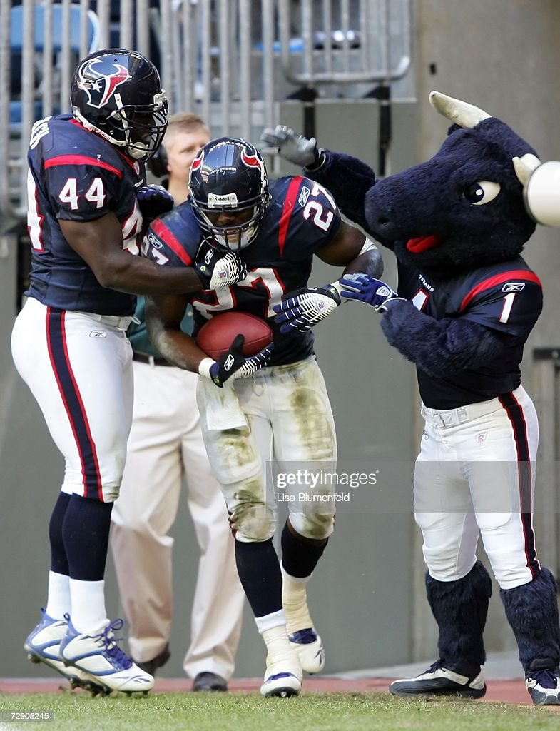 Chris Taylor of the Houston Texans celebrates with teammate Vonta Leach and Texans Mascot Toro after scoring his first NFL touchdown against the...