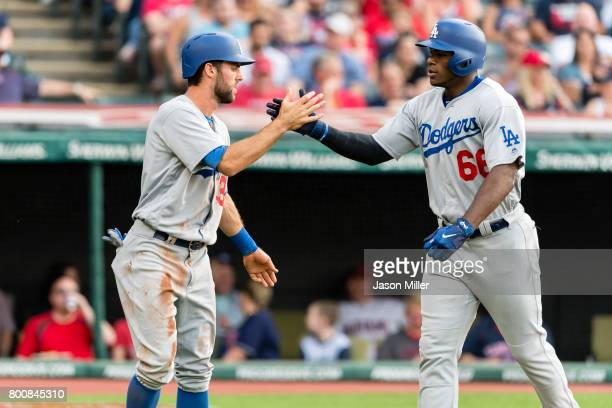 Chris Taylor of the Los Angeles Dodgers and Yasiel Puig celebrate after both scoring during the second inning against the Cleveland Indians at...