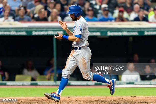 Chris Taylor of the Los Angeles Dodgers celebrates after scoring during the eighth inning against the Cleveland Indians at Progressive Field on June...