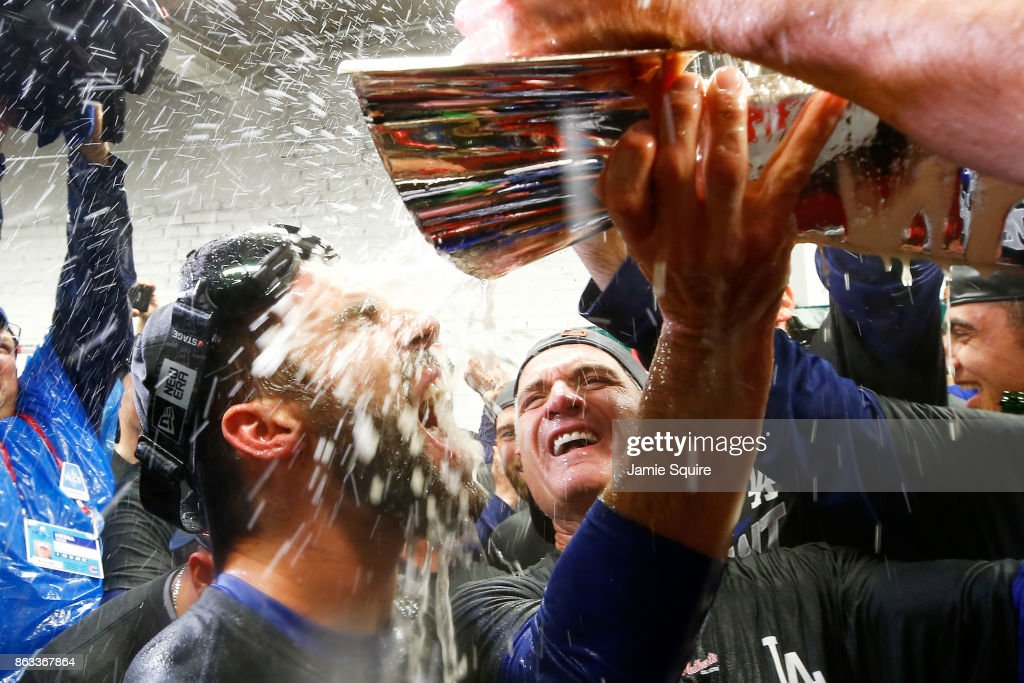 Chris Taylor #3 of the Los Angeles Dodgers celebrates in the clubhouse after defeating the Chicago Cubs 11-1 in game five of the National League Championship Series at Wrigley Field on October 19, 2017 in Chicago, Illinois. The Dodgers advance to the 2017 World Series.