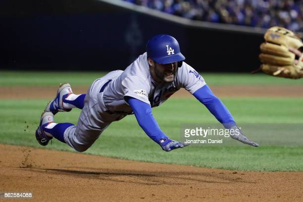 Chris Taylor of the Los Angeles Dodgers dives into third base for a triple in the fifth inning against the Chicago Cubs during game three of the...