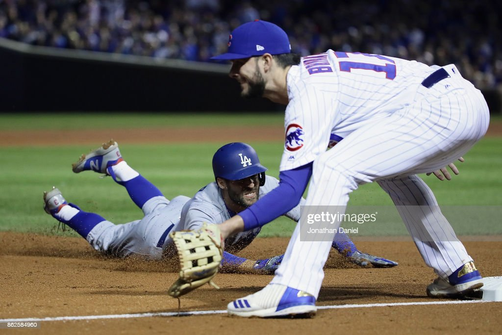 Chris Taylor #3 of the Los Angeles Dodgers dives into third base for a triple past Kris Bryant #17 of the Chicago Cubs in the fifth inning during game three of the National League Championship Series at Wrigley Field on October 17, 2017 in Chicago, Illinois.