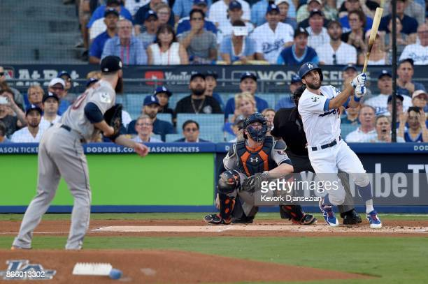 Chris Taylor of the Los Angeles Dodgers hits a solo home run during the first inning against the Houston Astros in game one of the 2017 World Series...
