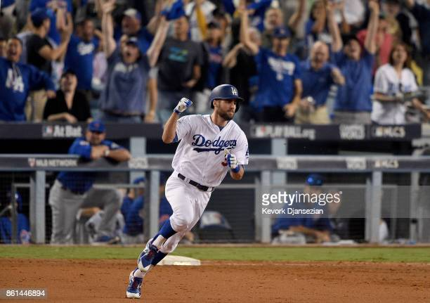 Chris Taylor of the Los Angeles Dodgers hits a solo home run to right field against the Chicago Cubs during the sixth inning in Game One of the...